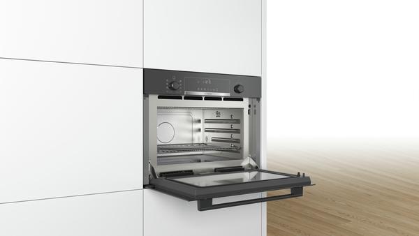 bosch einbau mikrowelle mit dampfgarfunktion coa565gb0 vulkan schwarz hai end. Black Bedroom Furniture Sets. Home Design Ideas